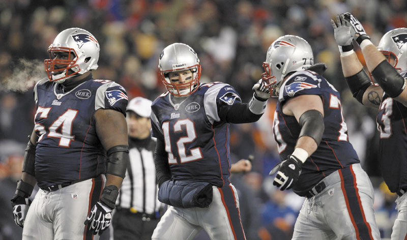 TOUGH TASK: New England Patriots offensive lineman Brian Waters, left, and Logan Mankins, right, are part ofa a group that will try to give quarterback Tom Brady, center, time to pass against a strong New York Giants defense in Super Bowl XLVI. playoff playoffs