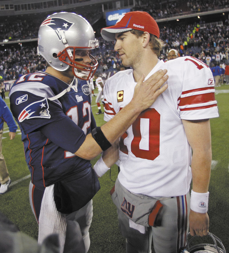 WINNERS: New England Patriots quarterback Tom Brady, left, has won three Super Bowls, while New York Giants quarterback Eli Manning, right, has won one.