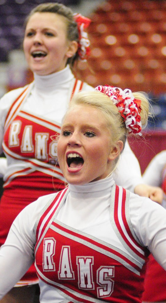 HERE WE GO: Cony High School's Leah Howard-Berry, top, and Alyssa Brochu yell out a cheer during the Eastern Maine Class A cheerleading competition Saturday night at the Augusta Civic Center.