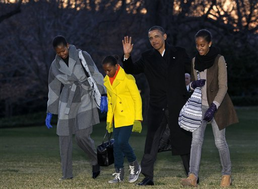 President Barack Obama, first lady Michelle Obama and their daughters Sasha and Malia arrive on the South Lawn of the White House, Tuesday, Jan. 3, 2012, in Washington. The first family was returning from their family vacation to Hawaii. (AP Photo/Haraz N. Ghanbari) President Barack Obama, first lady Michelle Obama and their daughters Sasha and Malia arrive on the South Lawn of the White House, Tuesday, Jan. 3, 2012, in Washington. The first family was returning from their family vacation to Hawaii. (AP Photo/Haraz N. Ghanbari)