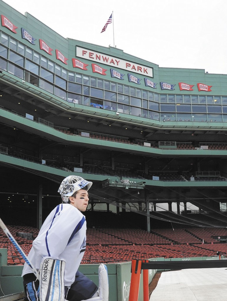 PLAY HOCKEY: Martin Ouelette of the University of Maine hockey team steps out of the Red Sox dugout and into Fenway Park on Friday, January 6 to practice for Saturday's Frozen Fenway game vs. UNH.