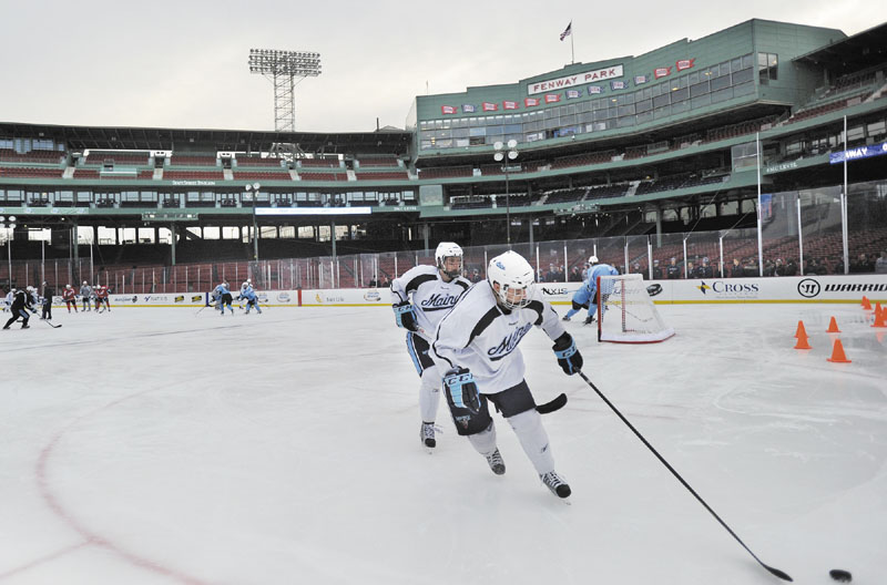 The University of Maine hockey team practices at Fenway Park in Boston on Friday, to prepare for Saturday's game vs. UNH at the historic ballpark in Boston.