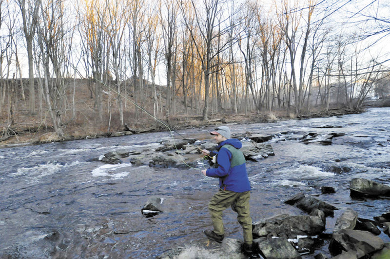 NICE DAY TO WET A LINE: Aaron Landry of Standish was one of approximately 70 fly fishermen who participated in this year's Freeze Up gathering.