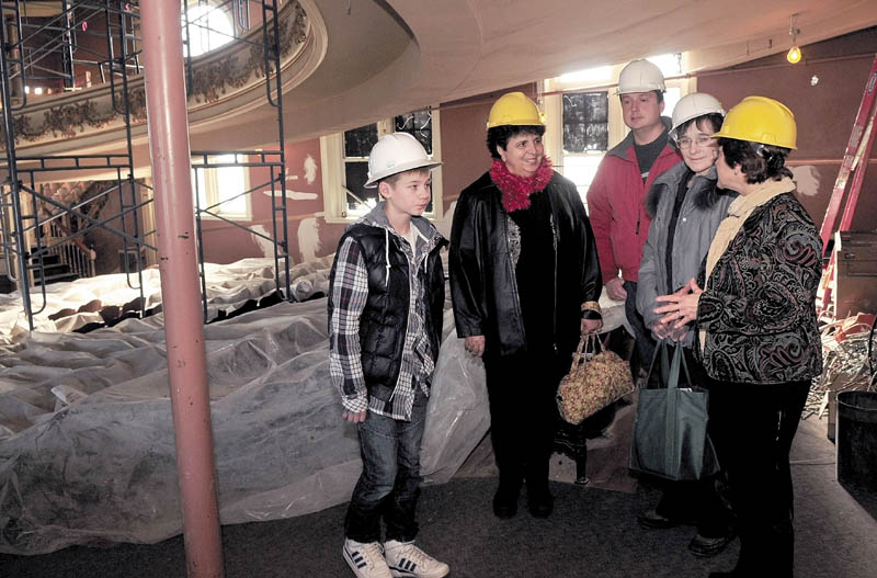 SISTER CITY: Anton Yeltsov, left, and Arina Pavlova, second from right, of Kotlas, Russia, listen to Barbara Allen, right, speak about renovations to the Waterville Opera House during a tour of city hall recently. Kotlas and Waterville are sister cities. Waterville hosts Martha Patterson and Mark Fisher led the tour.