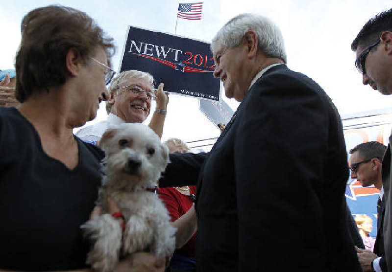 Republican presidential candidate Newt Gingrich campaigns at The PGA Center for Golf Learning and Performance, Saturday, in Port St. Lucie, Fla.