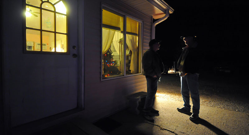 UP FOR GRABS: Chris Kreger and John Carr talk outside a caucus Tuesday night at Precinct 42 near Smithland, Iowa. This caucus race was jumbled as any in the 40 years since Iowa gained the presidential campaign lead-off position.