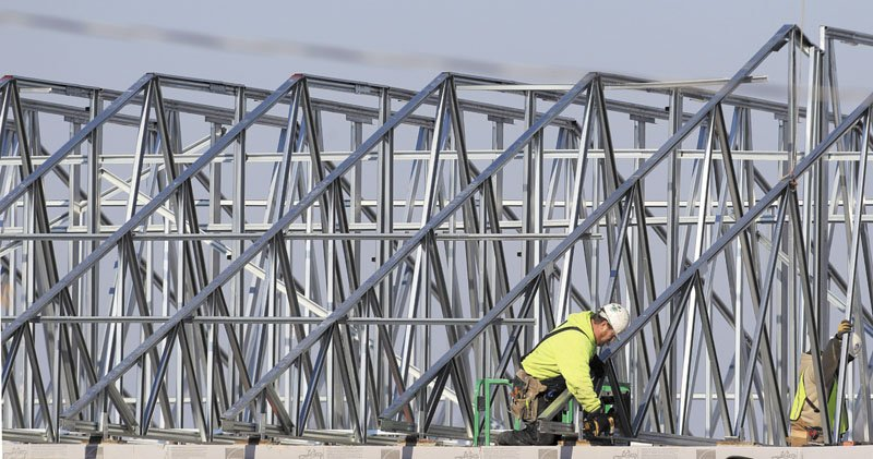 A construction worker installs trusses on a new addition at Chardon Hills Elementary School this week in Euclid, Ohio. A burst of hiring in December pushed the unemployment rate to its lowest level in nearly three years, giving the economy a boost at the end of 2011.