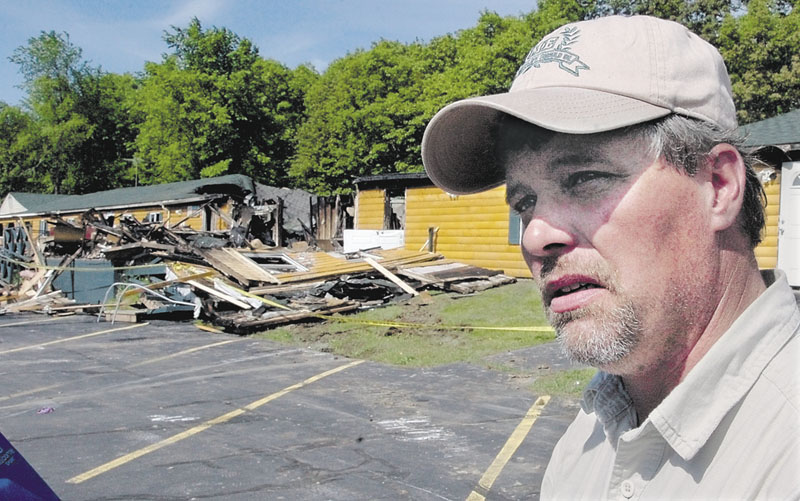 Former Grandview Topless Coffee Shop owner Donald Crabtree, seen here after his business burned down, questions whether authorities convicted the right man for the arson.