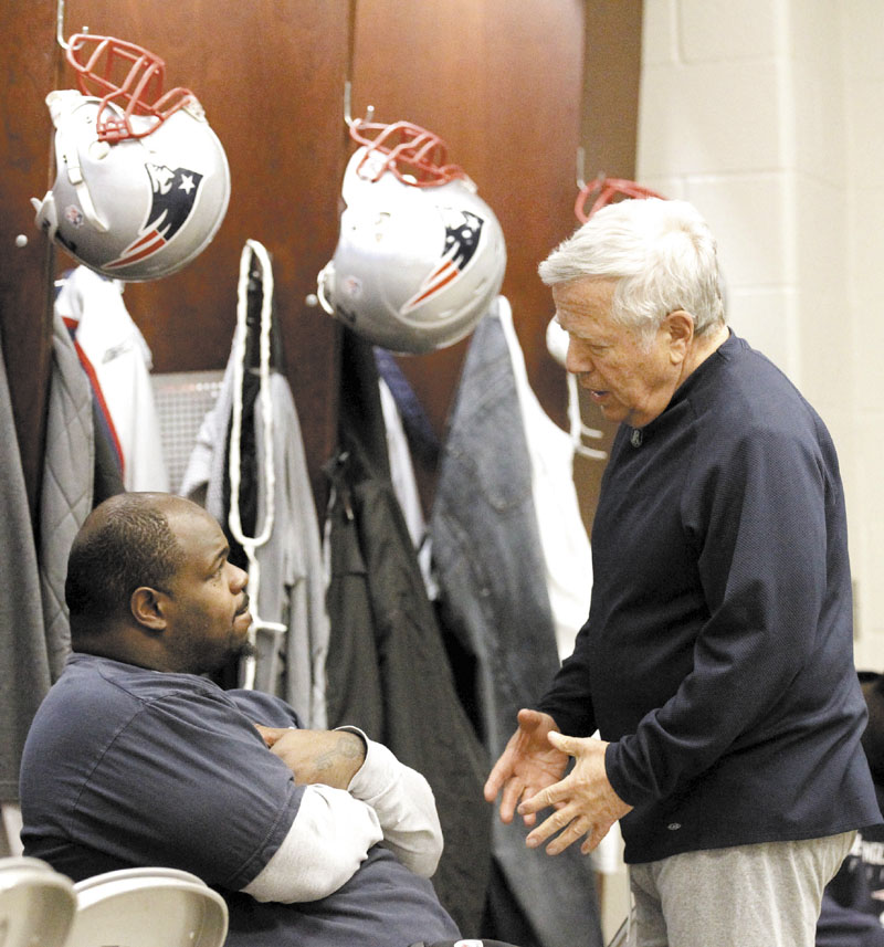 HEY BUDDY: New England Patriots owner Robert Kraft, right, talks with nose tackle Vince Wilfork in the Patriots locker room earlier this week. Kraft, whose wife Myra died earlier this year, said the team is an extended family for him.
