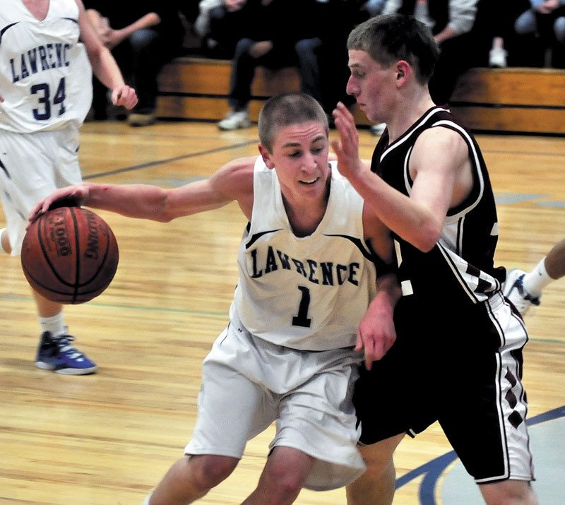 ON THE MOVE: Lawrence's Emmitt Faulkner tries to drive past Bangor's John Szewczyk during the Bulldogs' 45-41 win Tuesday in Fairfield.