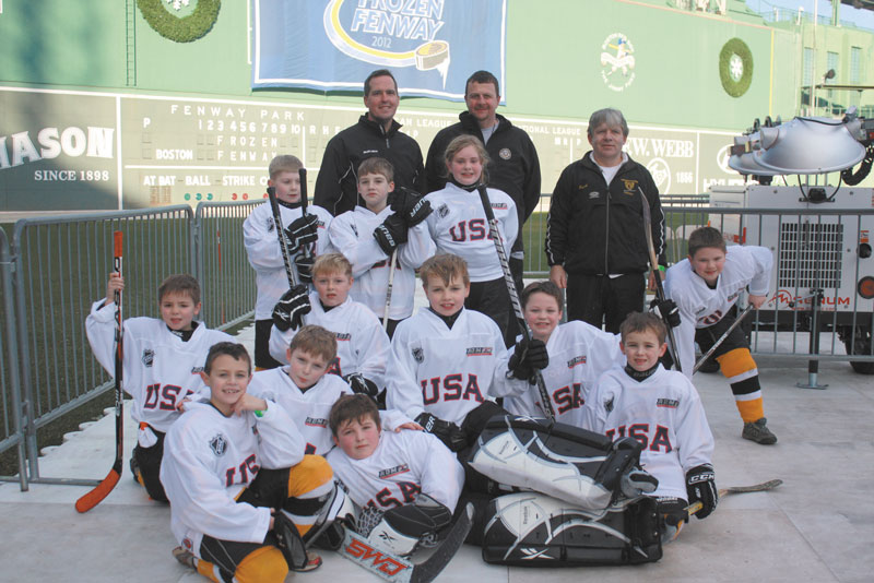 HERE WE ARE: The Maranacook Mites recently played at Fenway Park. Front from the left: Jacob Godbout, Chase Cloutier, Thomas Thornton (goalie). Second from from the left: Gavin Saucier, Wyatt Lyons, Jack Bonnefond, Adrian O'Connell, Carson Palmer. Back row of players: Thomas Clauson, Sam Linton, Savannah Mitchell, Nathan Miller. Coaches from the left: Head coach Mike Saucier, Steve Godbout, Gus Cloutier.