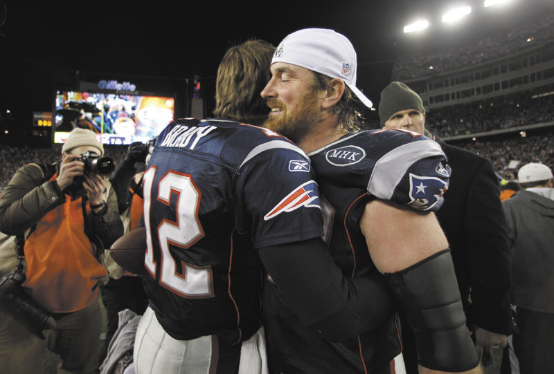 WE GOT YOUR BACK: Tackle Matt Light, right, is part of the New England Patriots' offensive line, which is responsible for keeping defenders away from quarterback Tom Brady (12). The Patriots' offensive line has been shuffled all season because of injuries. playoff playoffs