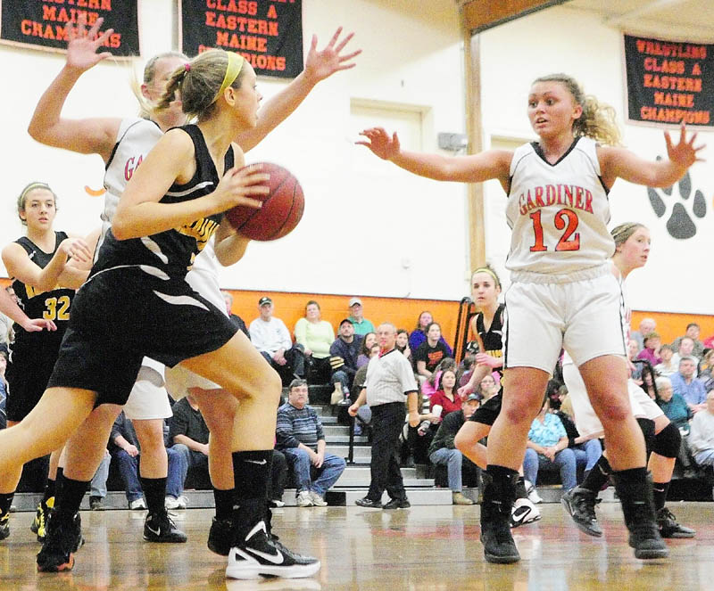 Maranacook's Hannah Cumler is guarded by Gardiner's Hillary Owen, behind her, and Taylor Bannister, right, during a game Thursday in the James A. Bragoli Memorial Gymnasium at Gardiner Area High School.