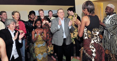 Gov. Paul LePage dances to African drumming this morning during a Martin Luther King Jr. breakfast at the Muskie Center in Warterville.