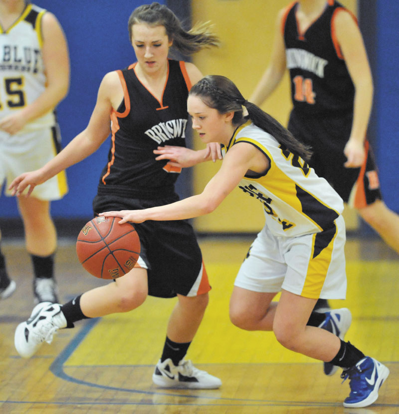 ON THE MOVE: Mt. Blue High School's Amy Hilton, right, recovers the ball as Brunswick High School's Lauren Carlton plays defense in the first quarter Friday at Mt. Blue Junior High School in Farmington.