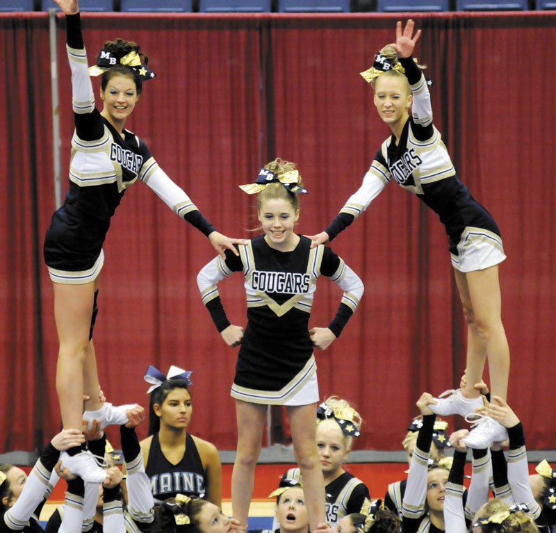 GIVE US AN M: The Mt. Blue cheerleaders finished fifth at the at the Kennebec Valley Athletic Conference Class A Cheerleading Championship on Monday at the Augusta Civic Center.