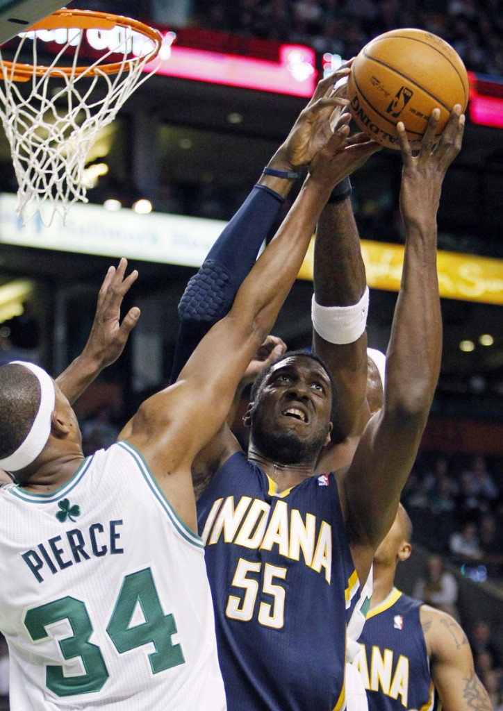 Indiana Pacers' Roy Hibbert (55) can not get the shot off against Boston Celtics' Paul Pierce (34) in the first quarter Friday in Boston.