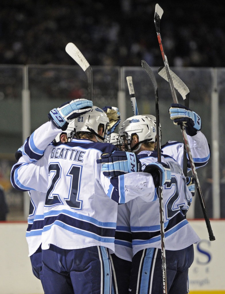 UMaine celebrates a first-period goal by Mark Anthoine, who got an assist from Kyle Beattie.