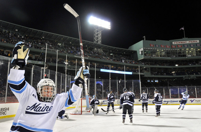 Joey Diamond celebrates teammate Brian Flynn's overtime goal Saturday night that gave the University of Maine a 5-4 victory over Hockey East rival New Hampshire at Fenway Park.