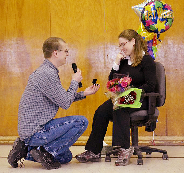 Bill Hensley proposes to Rebecca Lussier during a student assembly at Martel Elementary School in Lewiston on Monday afternoon. But her boyfriend, Bill Hensley