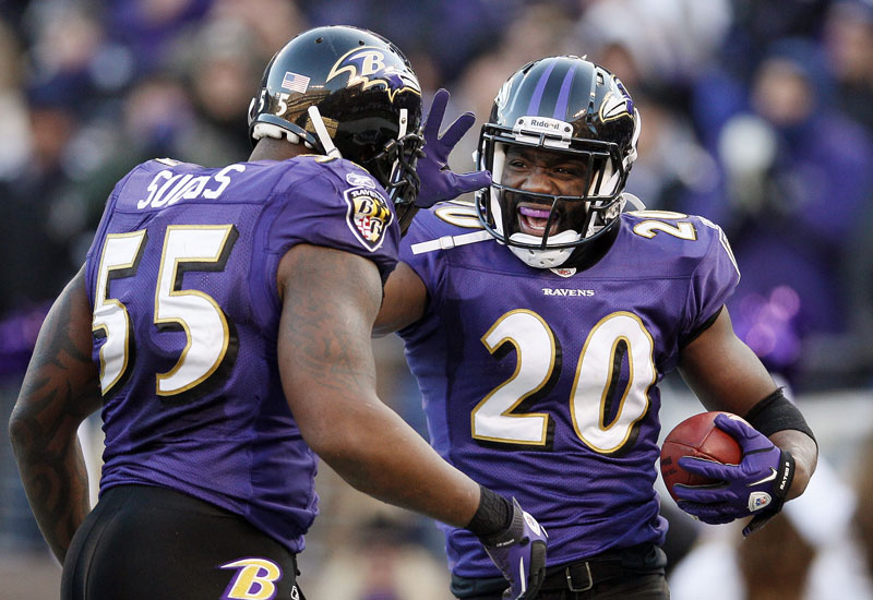 ALL RIGHT: Baltimore Ravens free safety Ed Reed, right, celebrates his interception with teammate Terrell Suggs during the Raven's 20-13 win over the Houston Texas on Sunday in Baltimore. The Ravens will face the Patriots in the AFC Championship Game.