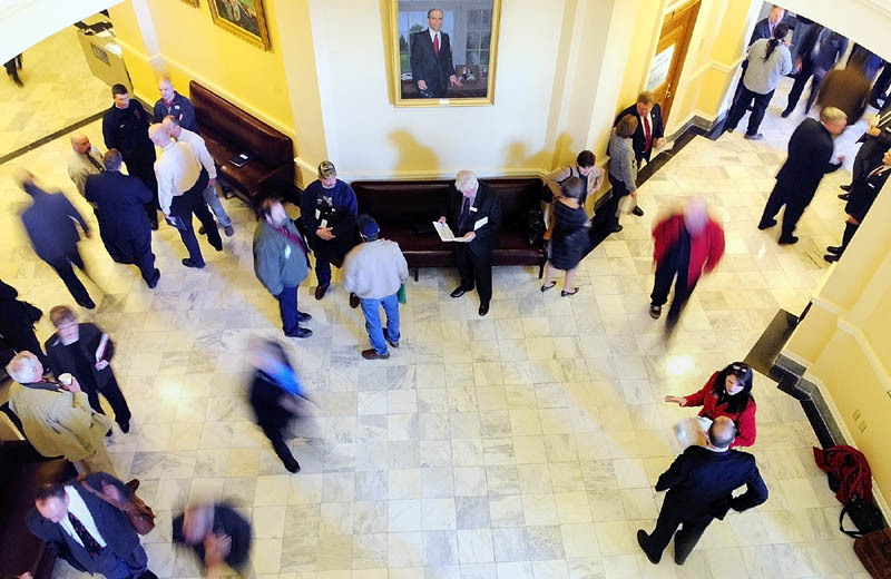 People move through the third floor between the House and Senate chambers on Wednesday at the State House in Augusta. It was the first day of the 125th Legislature's second legislative session.