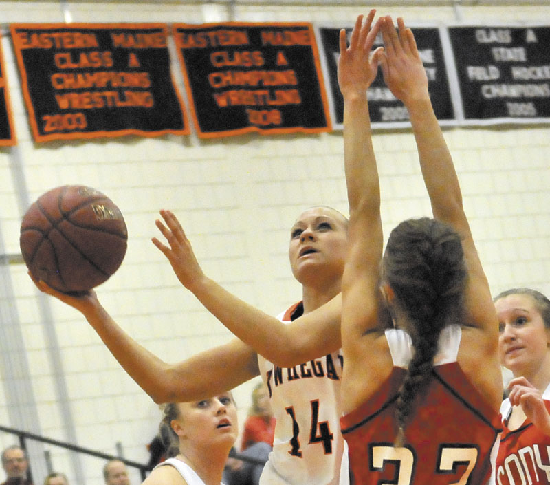 PRESSURE DEFENSE: Skowhegan Area High School's Amanda Johnson drives to the hoop as Cony High School's Josie Lee tries to defend her in the first half of the Indians' 49-36 loss Friday in Skowhegan.