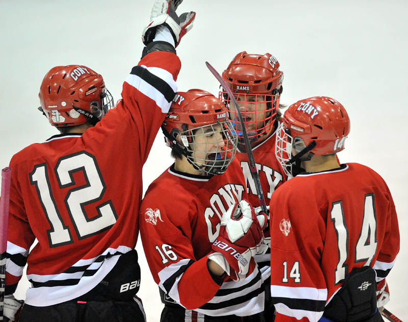 GOOD START: Cony High School's Aaron Manter (16) celebrates his first-period goal with teammates Zach Gagne, left, Dakota Bowie, back center, and Austin Davis during the Rams' 2-0 win over Skowhegan Area High School on Saturday at Sukee Arena in Winslow.