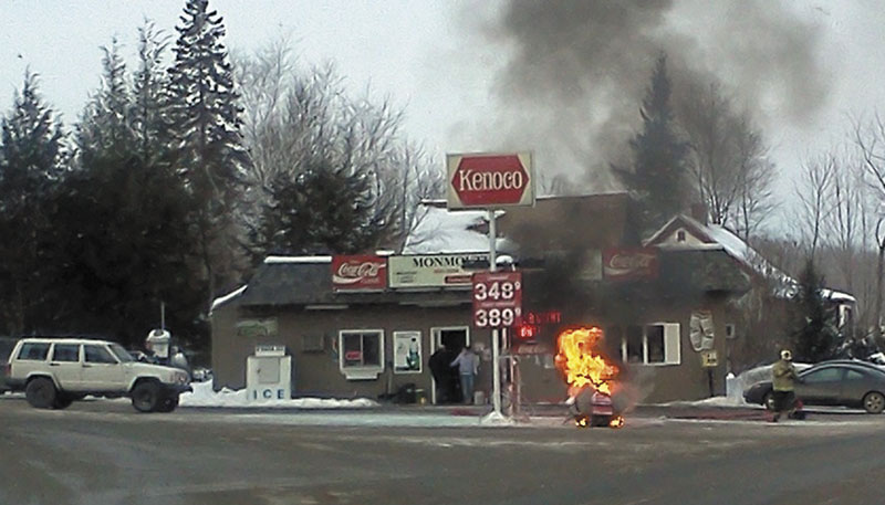 A snowmobile burns Sunday about 3:30 p.m. at the Monmouth Kwik Shop on Main Street in Monmouth.