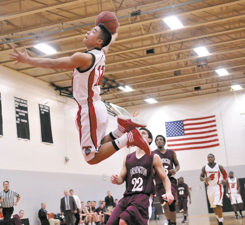 ON THE RISE: Thomas College's Antonio Juco dunks the ball on a fastbreak against University of Maine at Farmington during the Terriers' 81-73 win Saturday at Mahaney Gymnasium in Waterville.