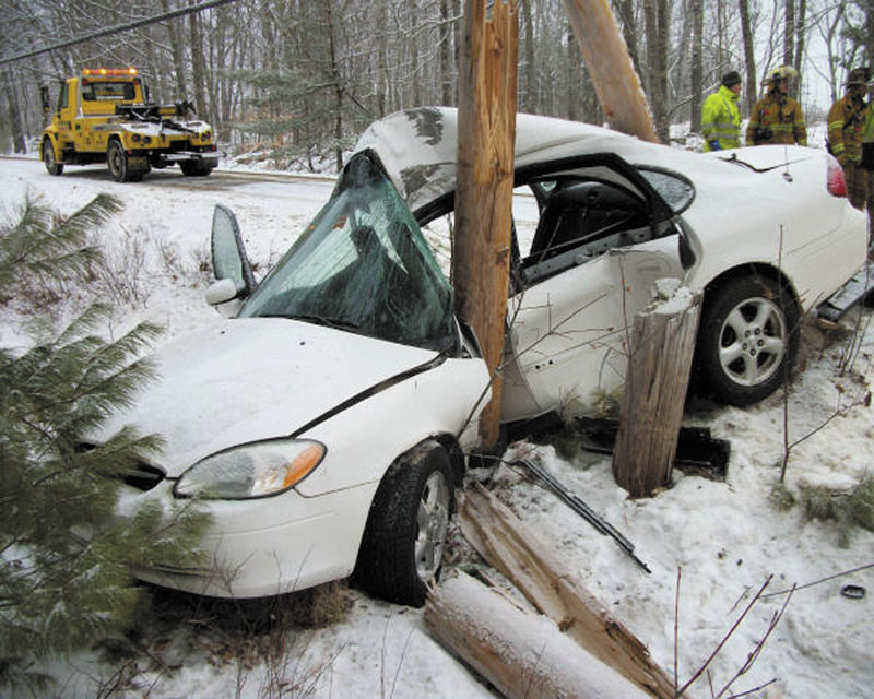 A car slid off Route 220 in Washington on Tuesday, crashing into a utility pole. The driver, a St. George teenager, was injured.