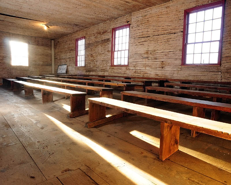 Tiered rows of benches line both sides of the the Wayne Town House. The historic building is located on Route 133 across the road from the state boat launch. The lathes are visible because the horse hair plaster was removed during the recent renovations.