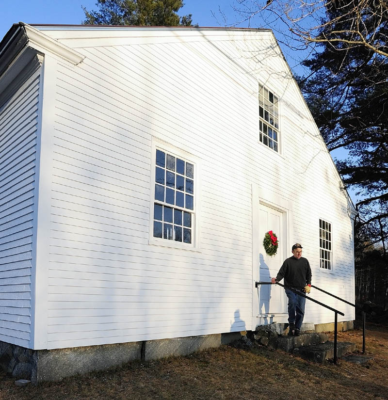 Bob Stephenson walks out of the Wayne Town House after giving a tour. The historic building is located on Route 133 across the road from the state boat launch.