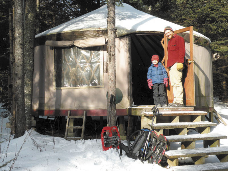 A PLACE TO STAY: Glen Widmer and his son, Isaac, stand outside the Goose Ridge Yurt in Montville. It offers overnight stays in the wilderness without needing to travel to the deep woods.