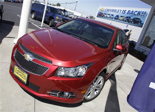 In this Aug. 30 photo, a 2011 Chevrolet Cruze is featured at a car dealership in San Jose, Calif. (AP Photo/Paul Sakuma)