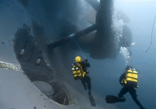 In this photo released by the Italian Fire Brigade, firemen scuba divers check one of the propellers of the luxury cruise ship Costa Concordia that run ashore off the Tuscany island of Isola del Giglio, Italy. (AP Photo/Vigili del Fuoco)