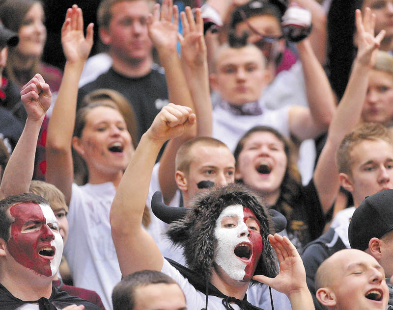 Nokomis High School senior Austin Chapman, bottom center, leads the student section in a cheer before their boys' team played Gardiner in an Eastern B quarterfinal at the Bangor Auditorium on Friday. Nokomis lost the game in overtime, 56-47.