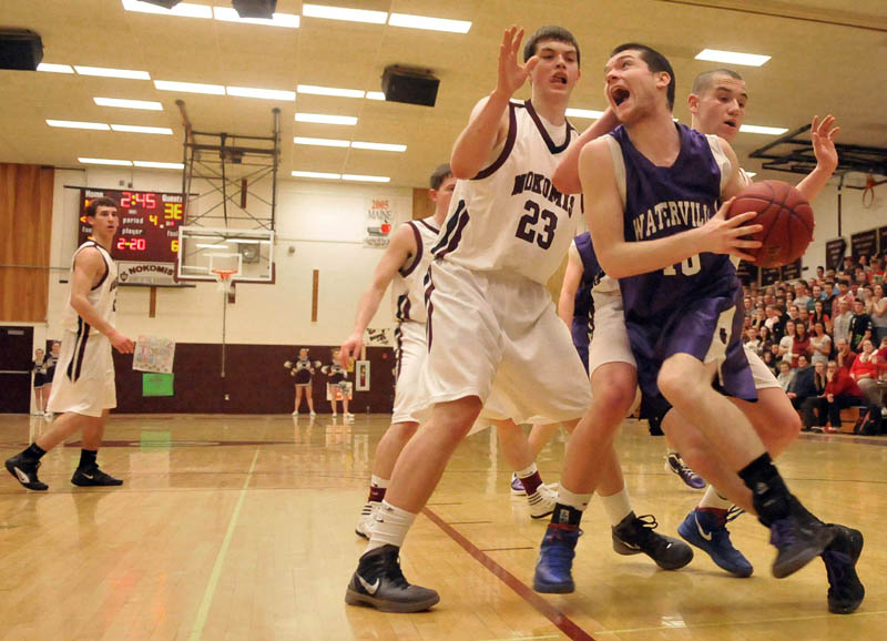 Photo by Michael G. Seamans Game action from Eastern Class B boys playoff game at Nokomis High School in Newport Wednesday night. Nokomis defeated Waterville 50-49 in overtime..