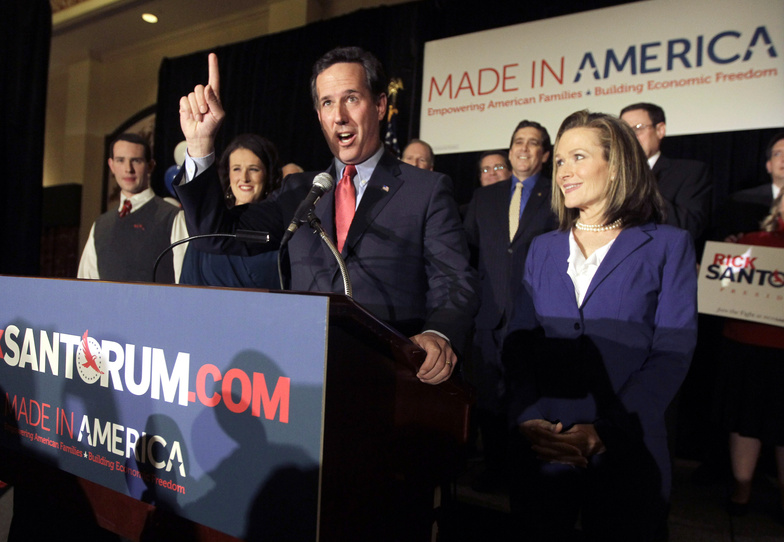 Republican presidential candidate former Pennsylvania Sen. Rick Santorum speaks to supporters Tuesday night in St. Charles, Mo. At right is his wife Karen. Among his wins Tuesday was a nonbinding primary in Missouri.