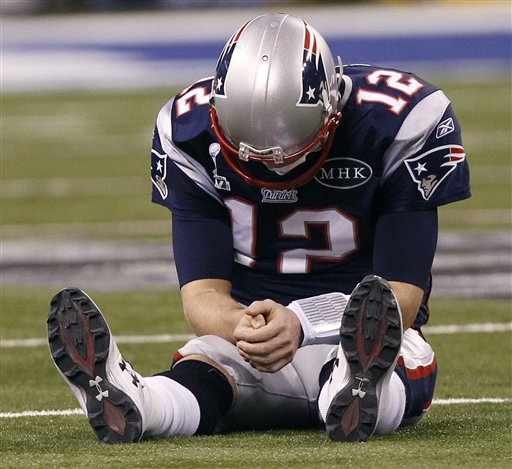 Patriots quarterback Tom Brady reacts after New York Giants linebacker Chase Blackburn intercepted Brady's pass intended for tight end Rob Gronkowski during the second half of the Super Bowl.