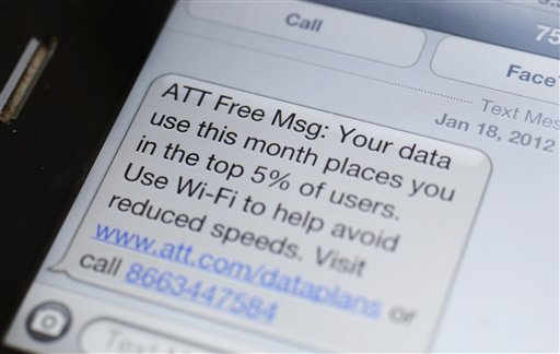The screen on a smartphone showing a text message to an AT&T customer in New York.