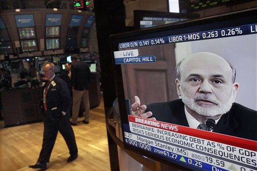 Federal Reserve Chairman Ben Bernanke's testimony before the House Budget Committee is visible on a television screen on the floor of the New York Stock Exchange today.