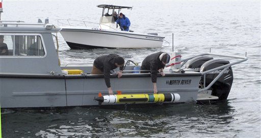Researchers lower an underwater robot into Block Island Sound off the Westerly, R.I., coast on Wednesday to explore a shipwreck thought to be the USS Revenge.