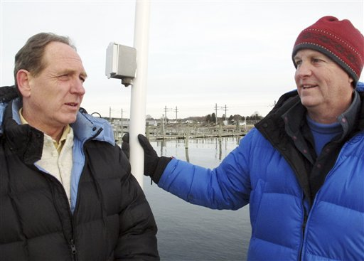 Craig Harger, left, and Charlie Buffum stand on a dock Wednesday in Stonington, Conn., before sailing into Block Island Sound where they have located a shipwreck thought to be the USS Revenge, commanded by Navy hero Oliver Hazard Perry.