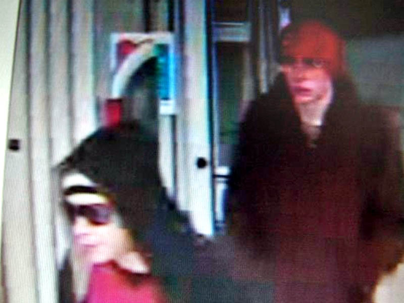 IN AUGUSTA: Police say these two are suspects in the robbery of a CVS.