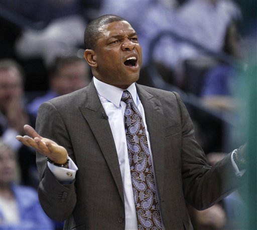 Boston Celtics coach Doc Rivers gestures during the first quarter of an NBA basketball game against the Oklahoma City Thunder in Oklahoma City, Wednesday, Feb. 22, 2012. (AP Photo/Sue Ogrocki)
