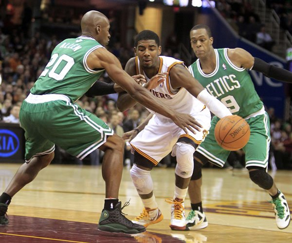 2ND HALF BEGINS: Cleveland Cavaliers point guard Kyrie Irving, center, drives between Boston Celtics guards Ray Allen left, and Rajon Rondo in the second quarter Tuesday night in Cleveland. Boston won 86-83.