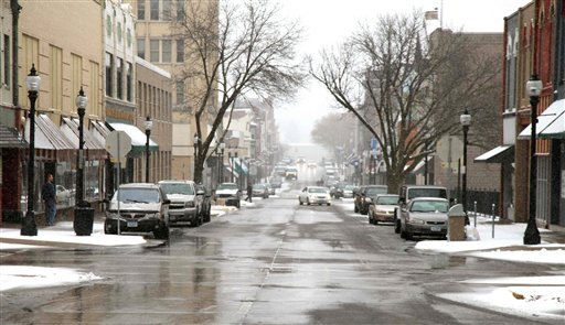 A light snow covers the streets of Muscatine, Iowa, today. China's likely future leader Xi Jinping will meet those who hosted him when he was a county official on a 1985 study tour.