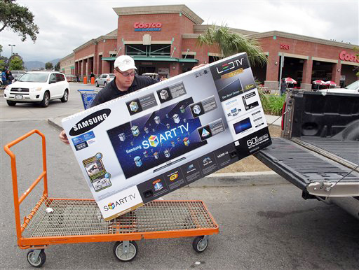 In this Feb. 27, 2012 photo, a shopper from Los Angeles, loads a 60 inch Samsung LED TV into his truck at Costco Wholesale store in Glendale, Calif. A private research group says that consumer confidence in February rose to the highest level since a year ago when the U.S. economy�s outlook started to look brighter before souring again. (AP Photo/Damian Dovarganes)