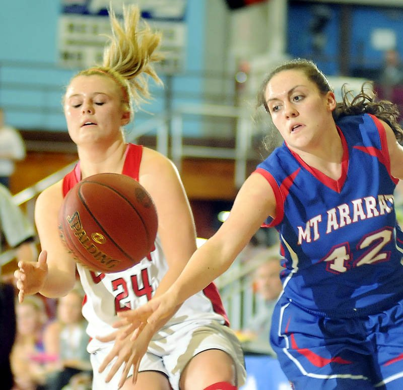 Cony High School's Emily Sanford, left, is stripped of the ball by Mt. Ararat High School's Mallory Nelson during a basketball match up Wednesday in Augusta.